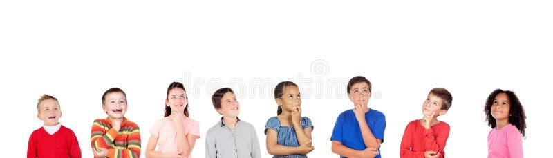 Eftertänksamma barn som tänker om något royaltyfria bilder