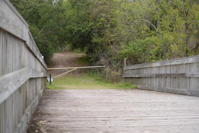 Egans Creek Greenway has old fashioned wood bridges to take you to the next wonderful adventure. Amelia Island`s Egans Creek Greenway offers an array of royalty free stock photography