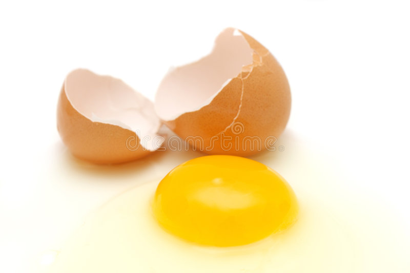 Egg. Broken egg with yolk, albumin and eggshell over white background stock photography