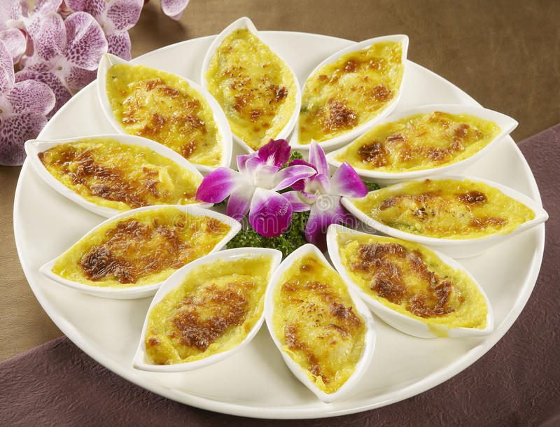 Egg cake in small tray on white plate in asian restaurant stock image
