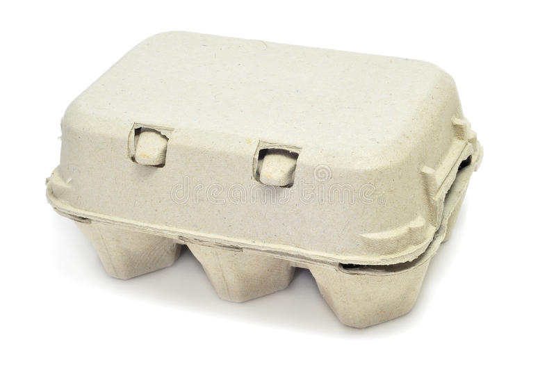 Egg carton. Eggs in an egg carton on a white background royalty free stock photo