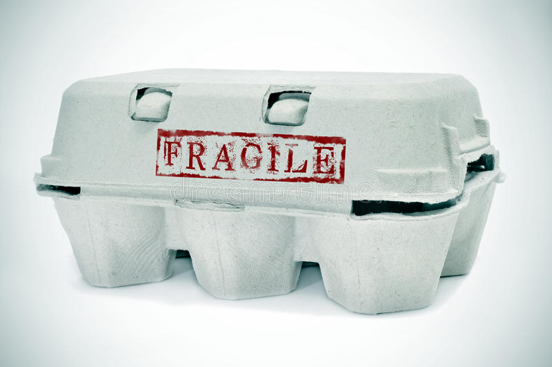 Egg carton. An egg carton with word fragile stamped on it stock photography