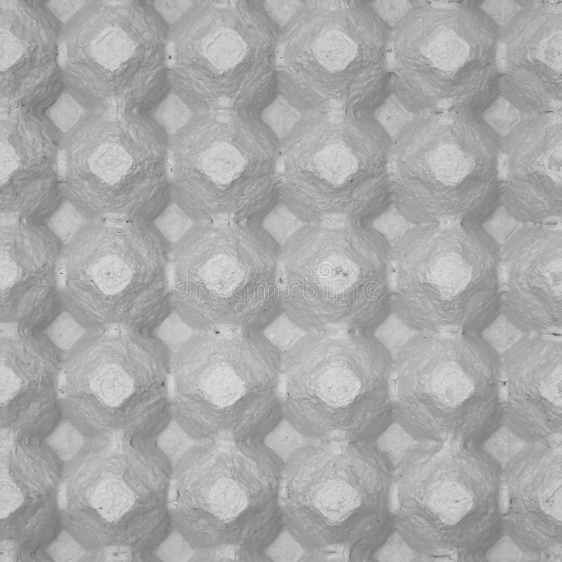 Egg carton background abstract. Texture of recycled material used in the making of egg carton stock photography