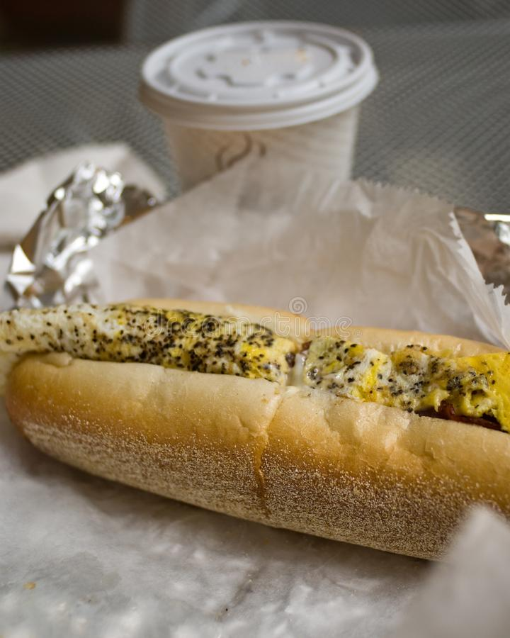 Egg and Cheese Sub in Philly. An egg and cheese sub in Philadelphia with a lot of pepper, with cup of coffee stock photos