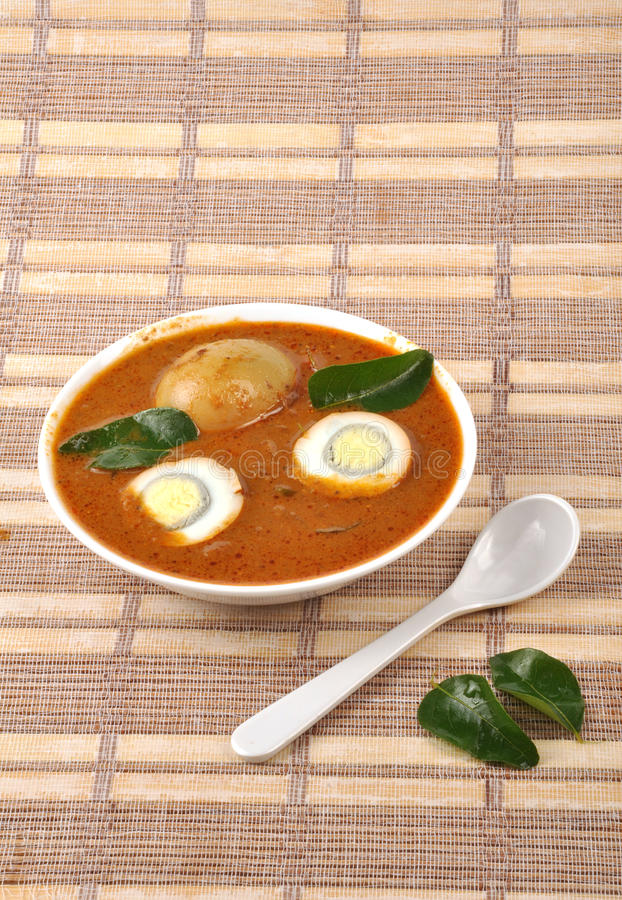 Egg curry. On bowl with fork stock photo