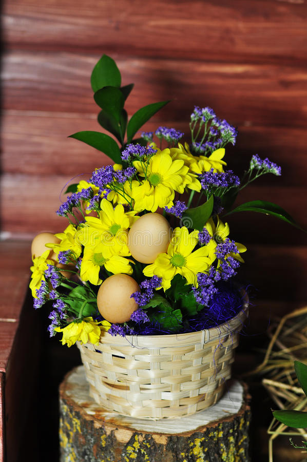 Egg. Easter eggs in a pot with a potted flower royalty free stock image