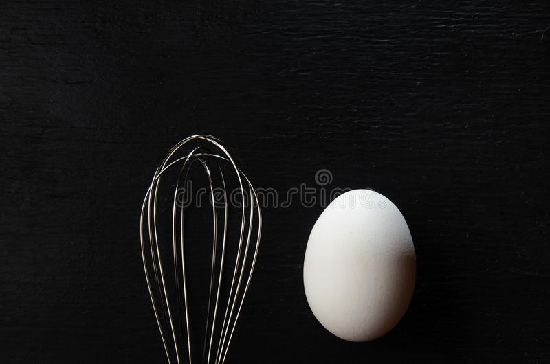 Egg and eggbeater stock image