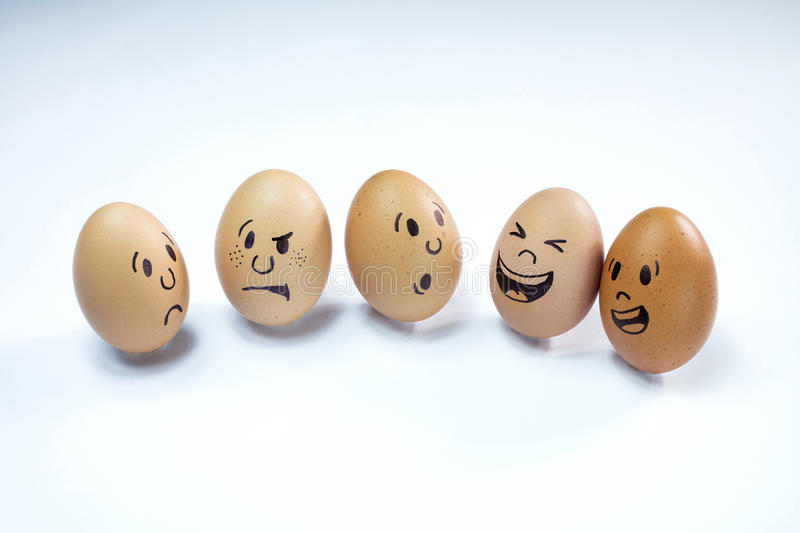 Egg faces with emotions stock image