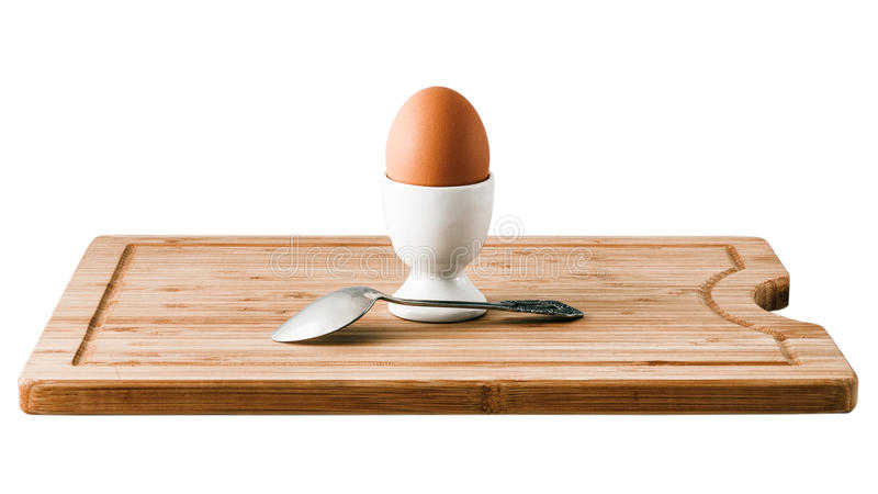 Egg holder with brown chicken egg and spoon. Healthy breakfast stock photography
