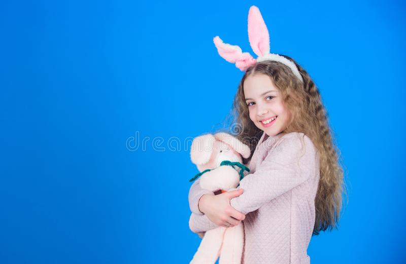 Egg hunt. Family holiday. Spring party. Little girl with hare toy. Happy easter. Child in rabbit bunny ears. copy space royalty free stock photos