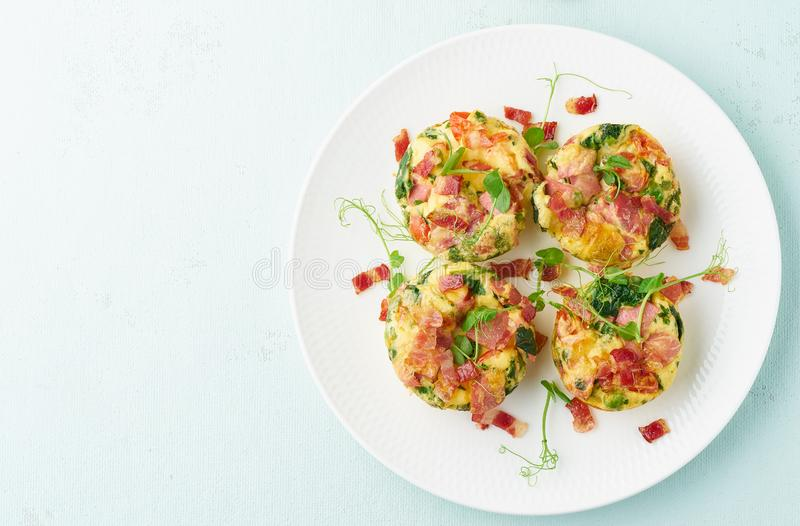Egg muffin baked with bacon, ketogenic keto diet, pastel modern top view copy space. Egg muffins with spinach and bacon, ketogenic keto diet low carb, pastel and stock image