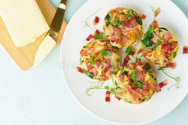 Egg muffin baked with bacon, ketogenic keto diet, pastel modern top view royalty free stock image