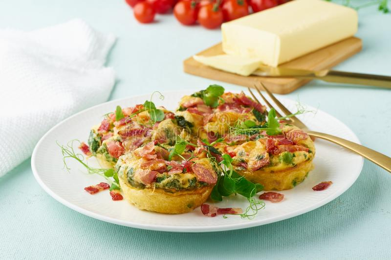 Egg muffin baked with bacon and tomato, ketogenic keto diet, pastel modern closeup stock photography