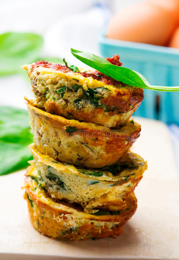 Egg Muffins with Sausage, Spinach, and Cheese. Selective focus stock images