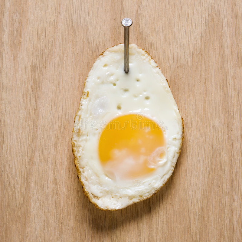 Free Egg Nailed To Wood. Royalty Free Stock Images - 2052149