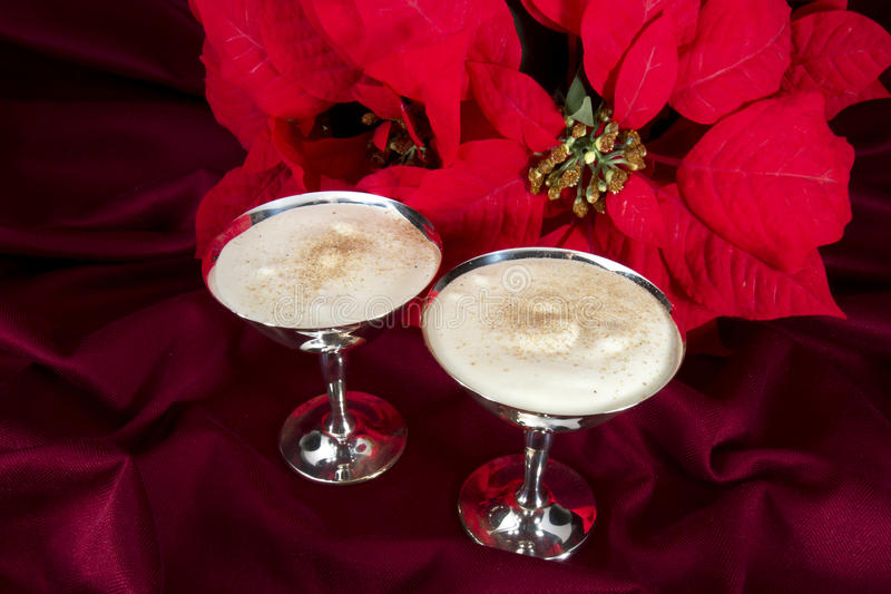 Egg Nogs with Poinsettia royalty free stock photos