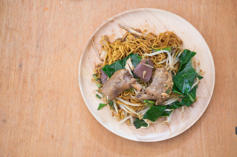 Egg noodle with bean sprout, chicken and pork blood pudding stock images
