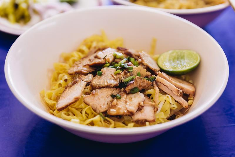 Egg noodle with sliced barbeque pork served with lime royalty free stock photo