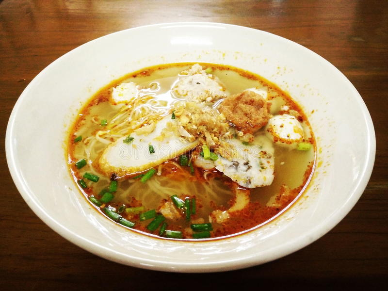 Egg noodle spicy soup with fish ball and shrimp ball royalty free stock photography