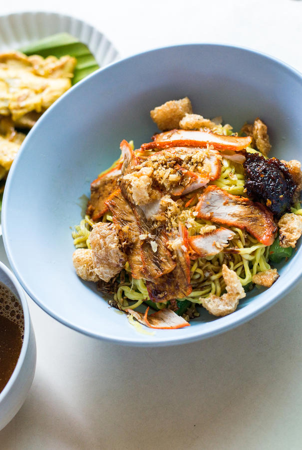 Egg noodles served dry with pork,Thai food royalty free stock photography