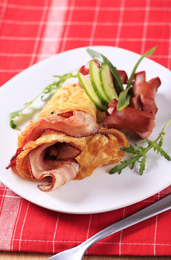 Egg omelet with bacon and sausages stock photos