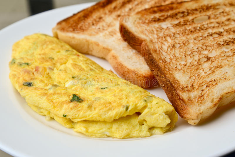 Egg omelet with toast royalty free stock image