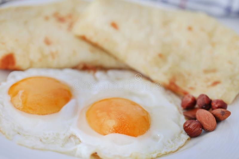 Egg omelet with tortilla bread stock images