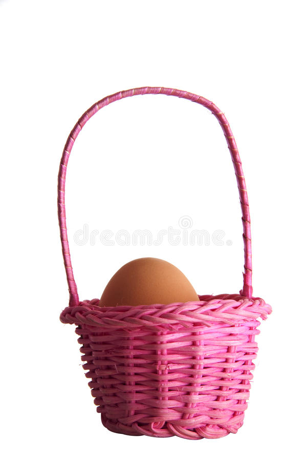 Download Egg In A Pink Basket Royalty Free Stock Image - Image: 21668996