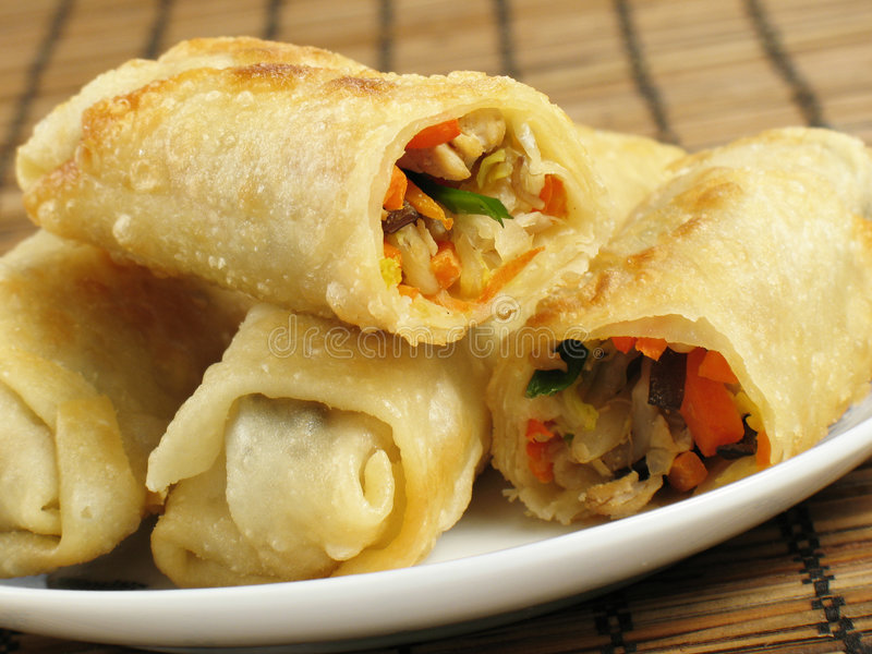 Egg Rolls. A delicious serving of egg rolls filled with chicken, napa cabbage, carrots, mung bean sprouts, wood ear fungus, and green onions stock images