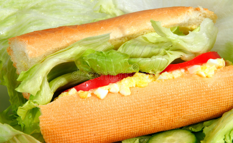 Egg salad in a bread stick roll stock images