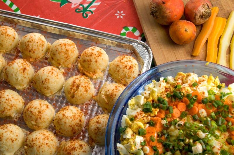Egg Salad, Mash Potatoes and Vegetables on Christmas Table for Family Meal. Salad, Mash Potatoes and Vegetables on Christmas Table for Family Meal Horizontal royalty free stock photo