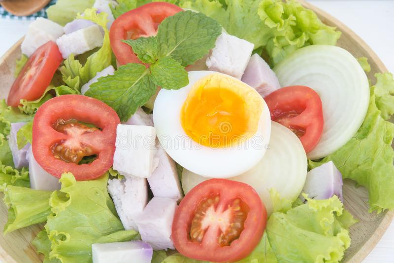 Egg salad in plate on food table. Egg salad in wood plate on food table stock photography