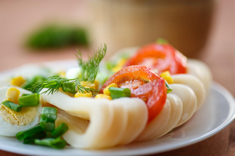 Egg salad and squid stock image