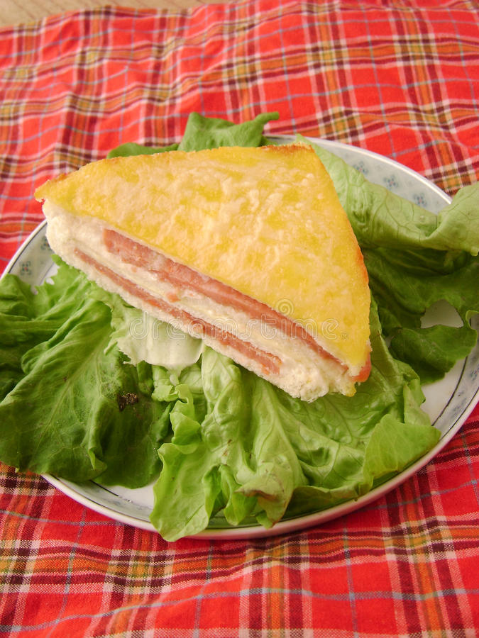 Egg sandwich with ham and lettuce stock image