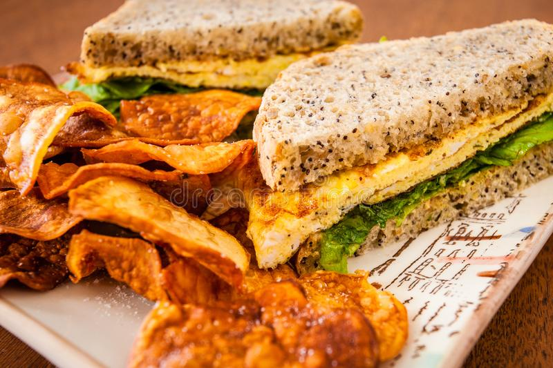 Egg sandwich and homemade chips stock photos