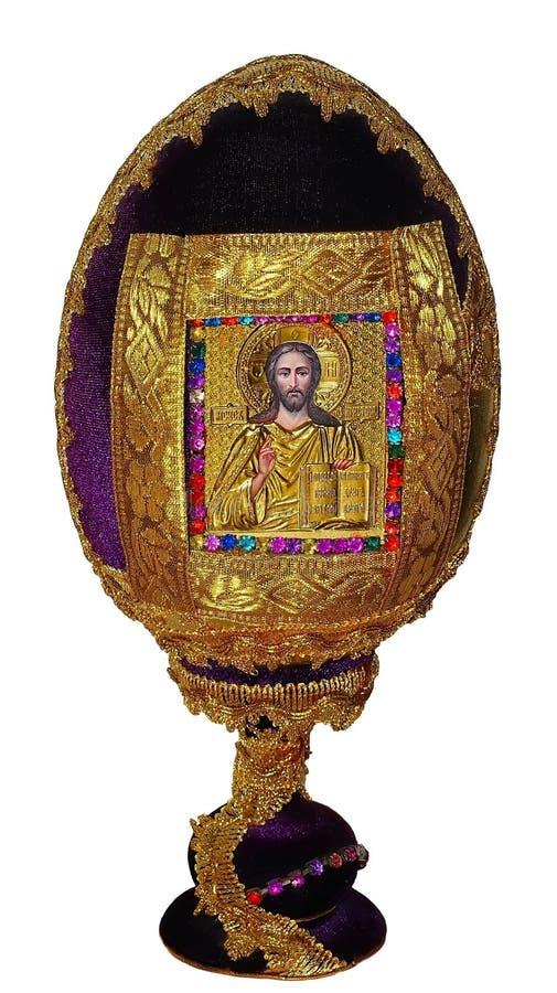 Egg su un supporto con l'icona del signore isolato su un fondo bianco fotografie stock libere da diritti