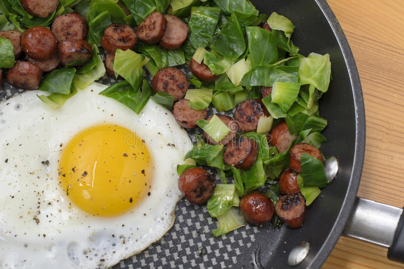 Egg sunny side up. With sausage and brussel sprouts stock image