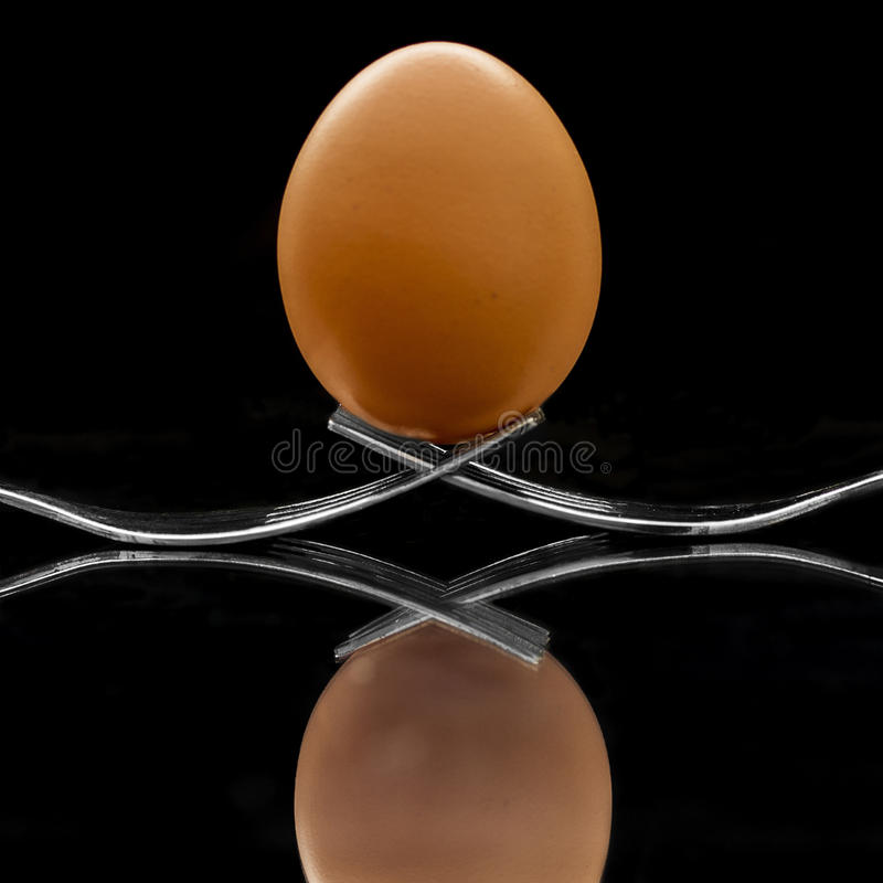Egg on top of forks stock image