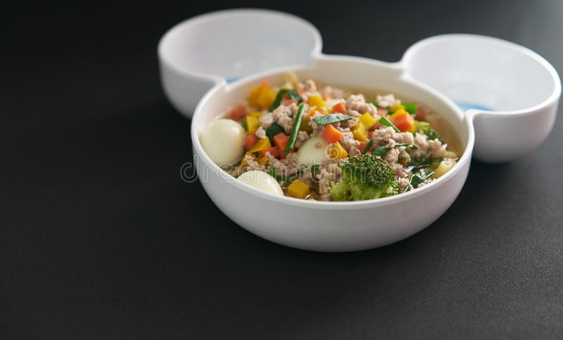 Egg vegetable and pork soup on black background royalty free stock photography