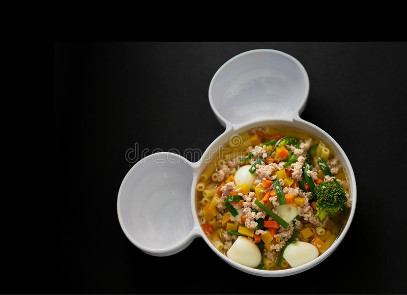 Egg vegetable and pork soup on black background,top view stock image