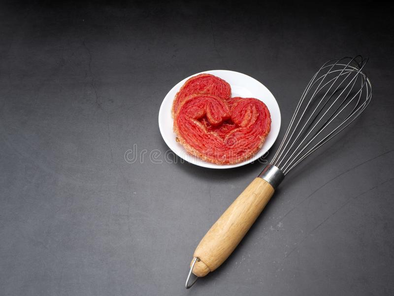 Egg whisk with Strawberry puff heart royalty free stock photo