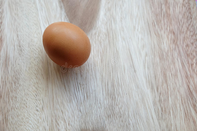 Egg on wood table royalty free stock images