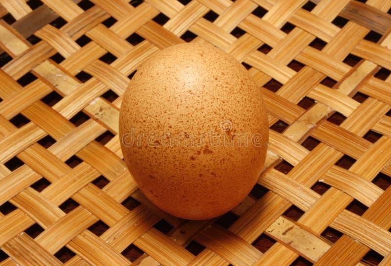 Egg on wooden basket. Closeup egg on wooden basket stock photos