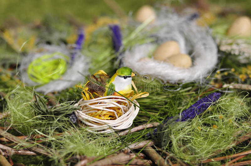 Egg. Yellow Easter egg in a nest for the birds royalty free stock photos