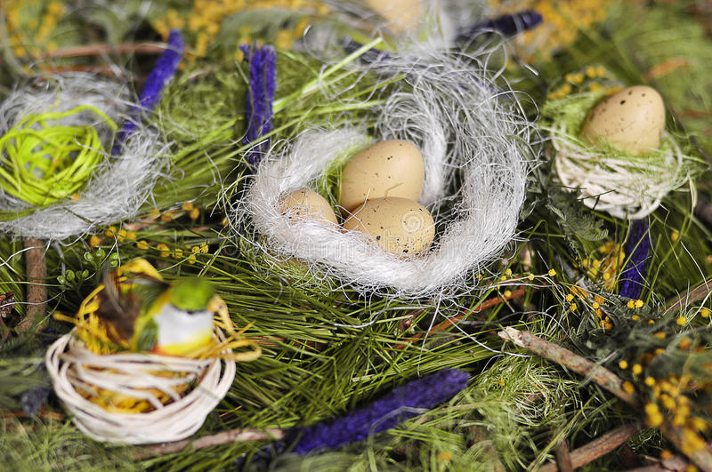 Egg. Yellow Easter egg in a nest for the birds stock photo