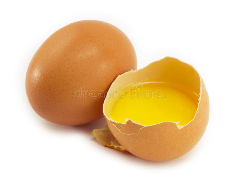 Egg yolk and egg. Two eggs, one broken egg, egg yolk stock images