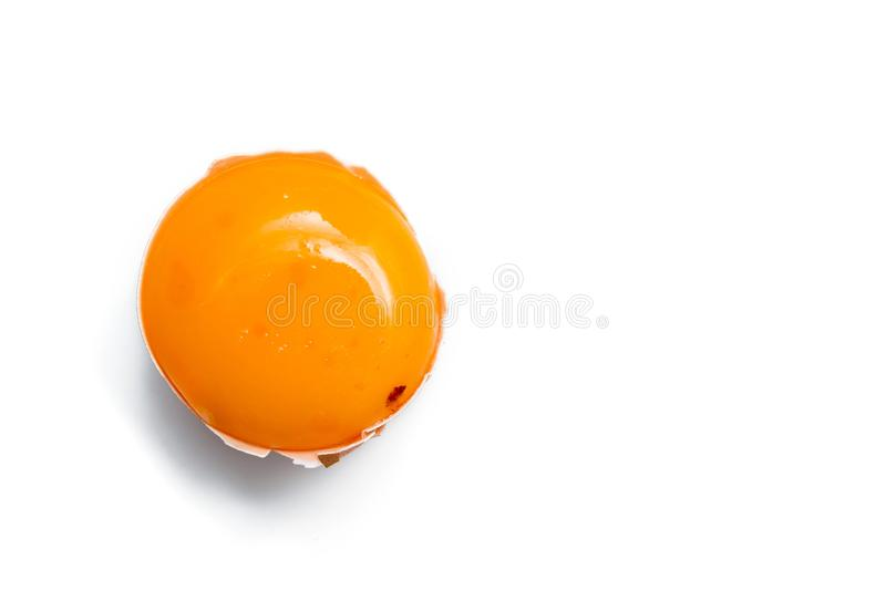 Egg yolk in egg shell. Cracked egg white isolated on white background stock photography