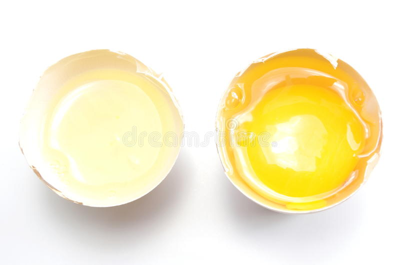 Egg yolk and white separate or divide concept. Horizontal stock image