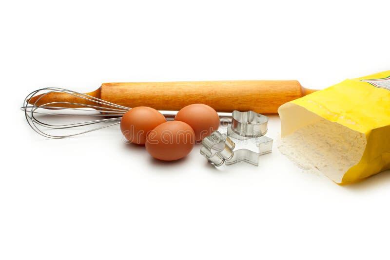 Eggbeater e ovos foto de stock