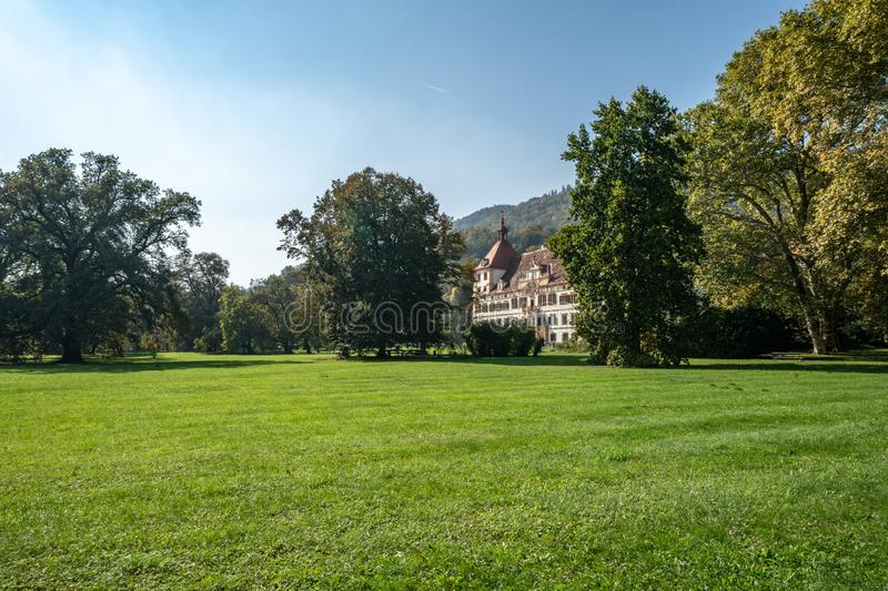 Schloss Eggenberg, Graz. The Eggenberg Palace in Graz, which is built to represent an exact calendar and the cosmic world. It`s moat now a green grassed space stock photos